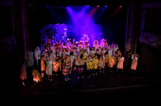Juniors Dazzle on Stage in 'Rock Bottom' Performance